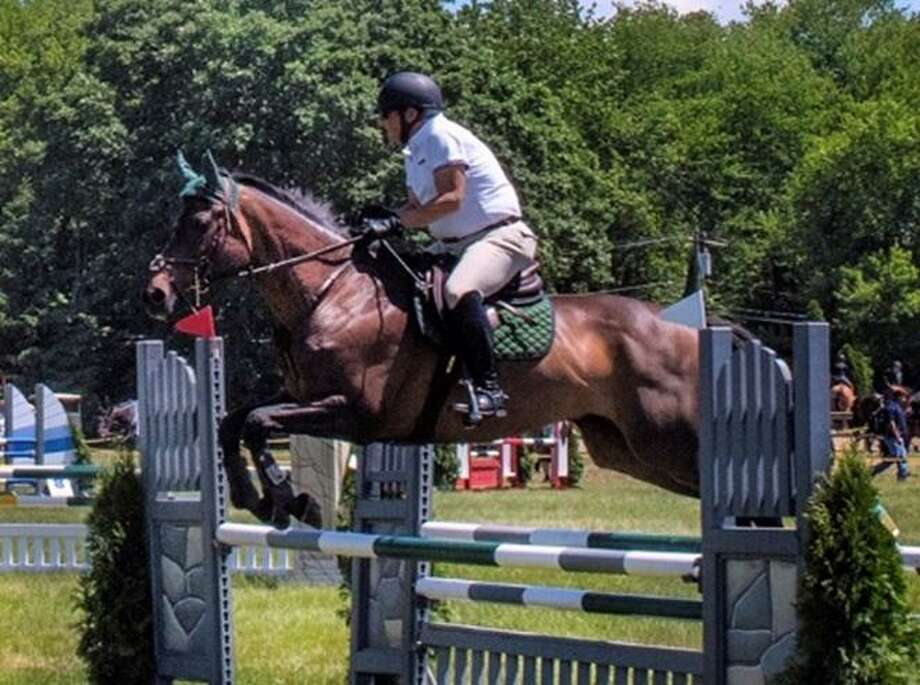 Bob Rose, a longtime Westport resident, and Stepping Stone Farm's Rocky decisively won the 2018 Championship ribbon in the Low Training Jumper division of the Fairfield Westchester Professional Horsemen's Association. Photo: Contributed Photo / Contributed Photo / Greenwich Time Contributed