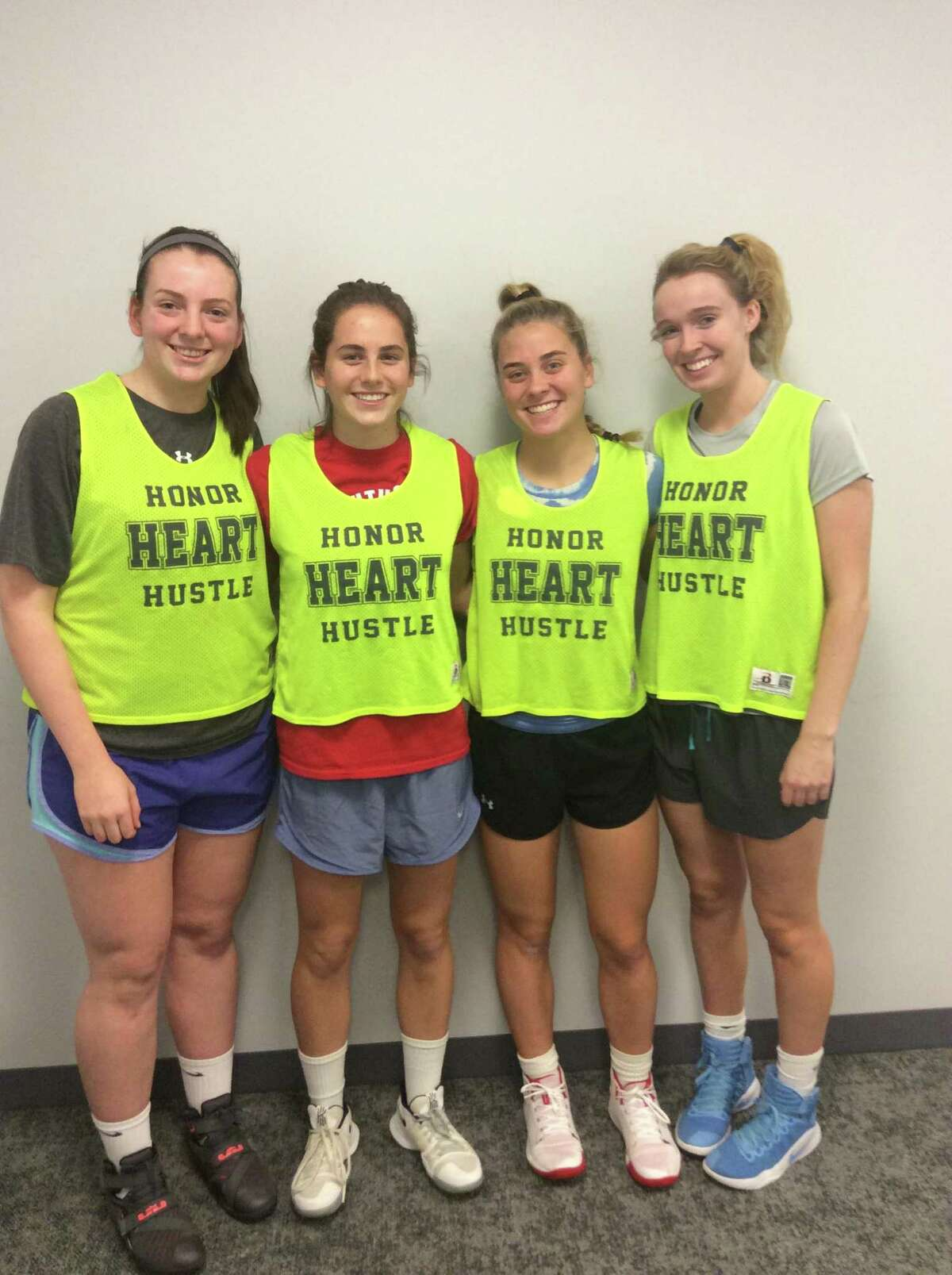 From left to right, Sarah Eckerson, Leah Atkins, Ryan Smith and Claire Liddy are senior captains on the Sacred Heart Greenwich basketball team, which opened its season with a win against Hotchkiss School on Saturday.