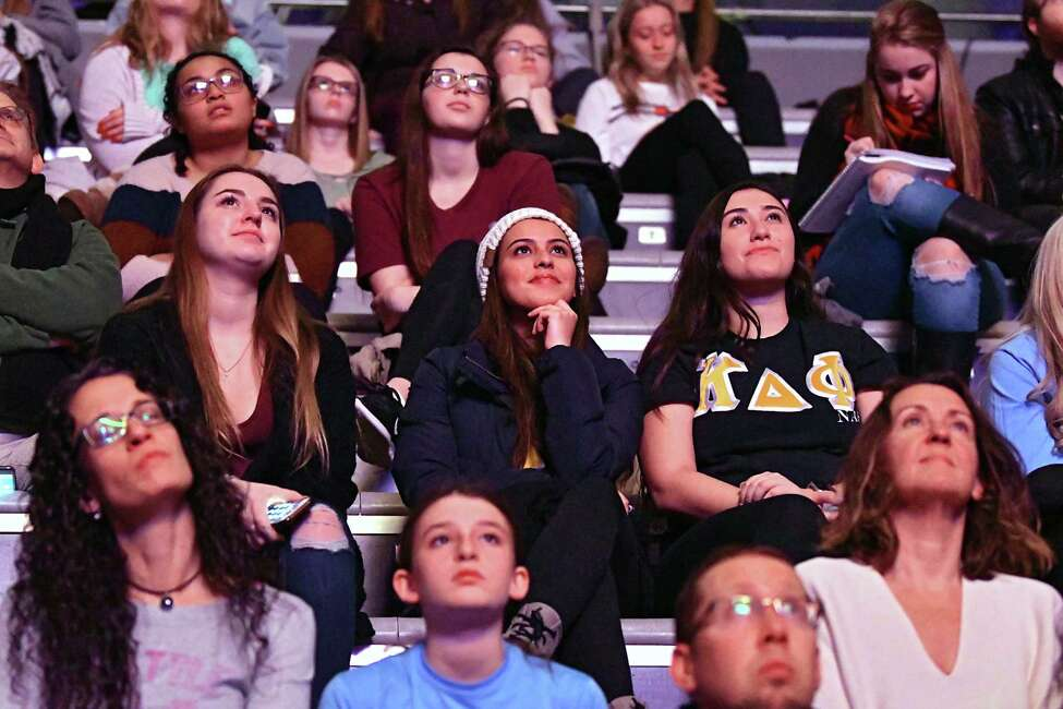 An audience watches a large screen as radio host Kathryn Zox sits on stage with U.S. Olympian and author Aly Raisman and asks her questions about her life experiences and new book at University at Albany's SEFCU Arena on Monday, Dec. 3, 2018 in Albany, N.Y. Raisman, a headliner for the University at Albany's Fall 2018 Speaker Series, was one of the scores of young female gymnasts who were victims of sexual abuse by doctor Larry Nassar. (Lori Van Buren/Times Union)
