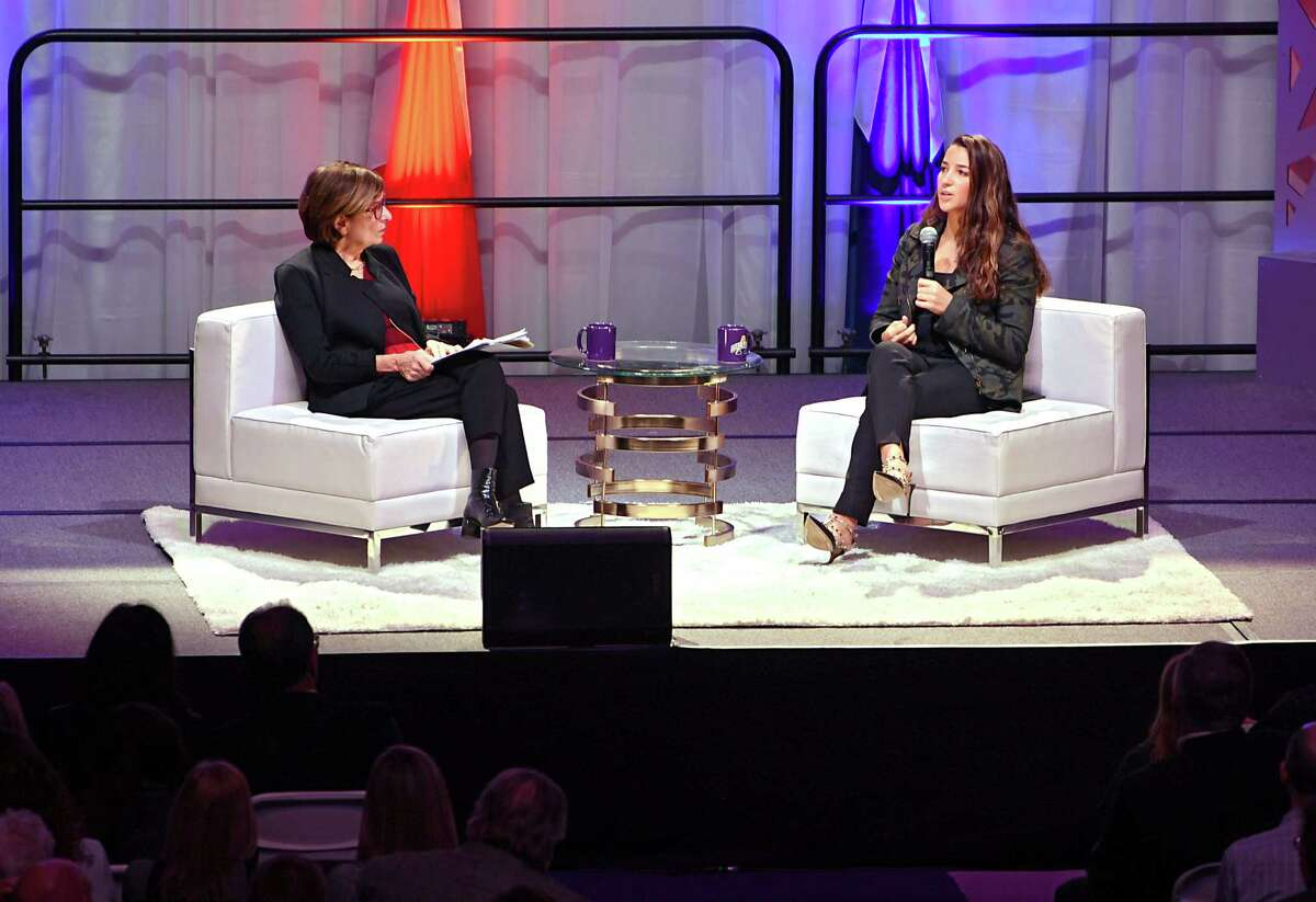 Radio host Kathryn Zox, left, sits on stage with U.S. Olympian and author Aly Raisman and asks her questions about her life experiences and new book at University at Albany's SEFCU Arena on Monday, Dec. 3, 2018 in Albany, N.Y. Raisman, a headliner for the University at Albany's Fall 2018 Speaker Series, was one of the scores of young female gymnasts who were victims of sexual abuse by doctor Larry Nassar. (Lori Van Buren/Times Union)