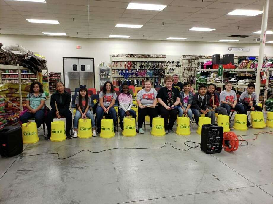 "College Hill and La Mesa Elementary school music students performed ""Sweet Home Alabama"" and ""I Got You"" with buckets last week at Gebo's. Photo: Courtesy Photos"