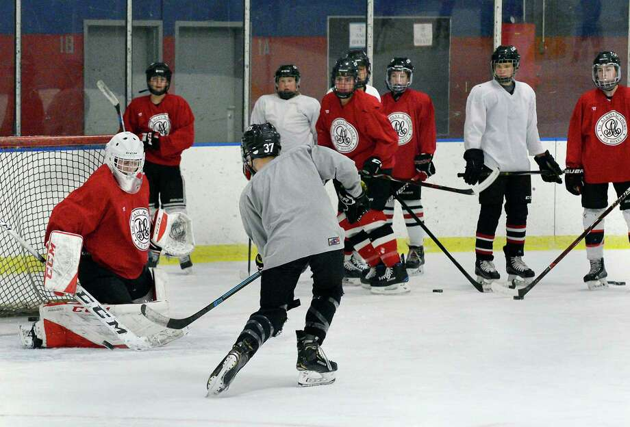 Albany Academy hockey players practice Friday Nov. 30, 2018 in Albany, NY.  (John Carl D'Annibale/Times Union) Photo: John Carl D'Annibale / 20045604A