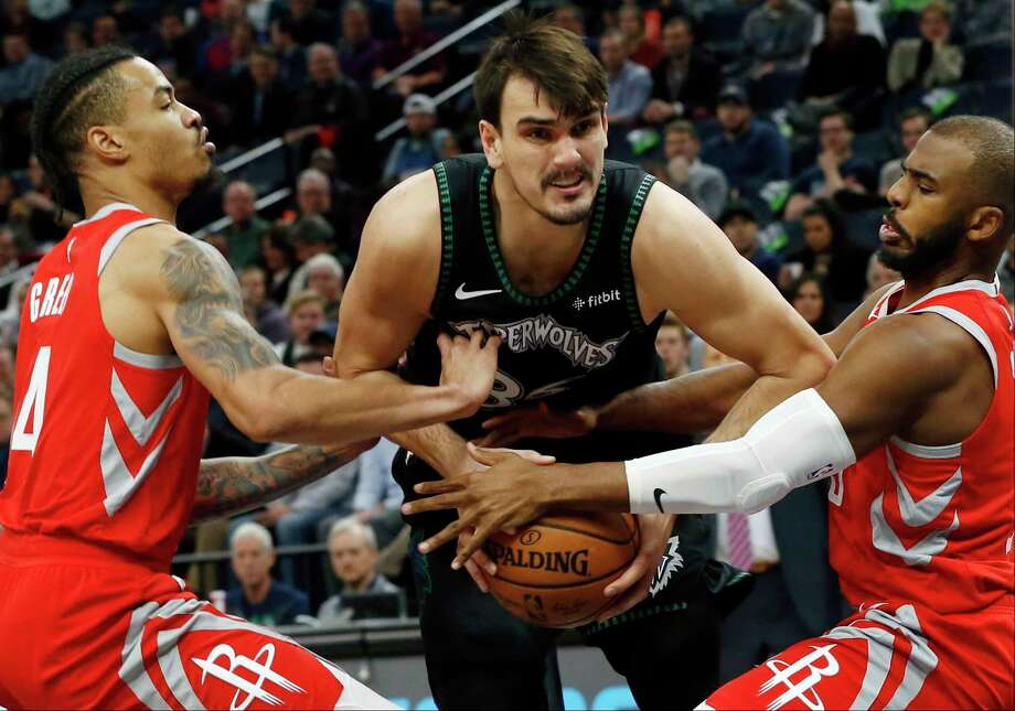 Minnesota Timberwolves' Dario Saric, center, of Croatia, is double-teamed by Houston Rockets' Gerald Green, left, and Chris Paul in the first half of an NBA basketball game Monday, Dec. 3, 2018, in Minneapolis. (AP Photo/Jim Mone) Photo: Jim Mone, Associated Press / Copyright 2018 The Associated Press. All rights reserved.