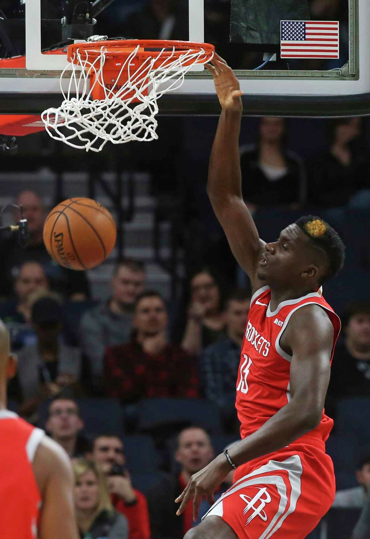 Houston Rockets' Clint Capela of Switzerland dunks against the Minnesota Timberwolves in the first half of an NBA basketball game Monday, Dec. 3, 2018, in Minneapolis. (AP Photo/Jim Mone)