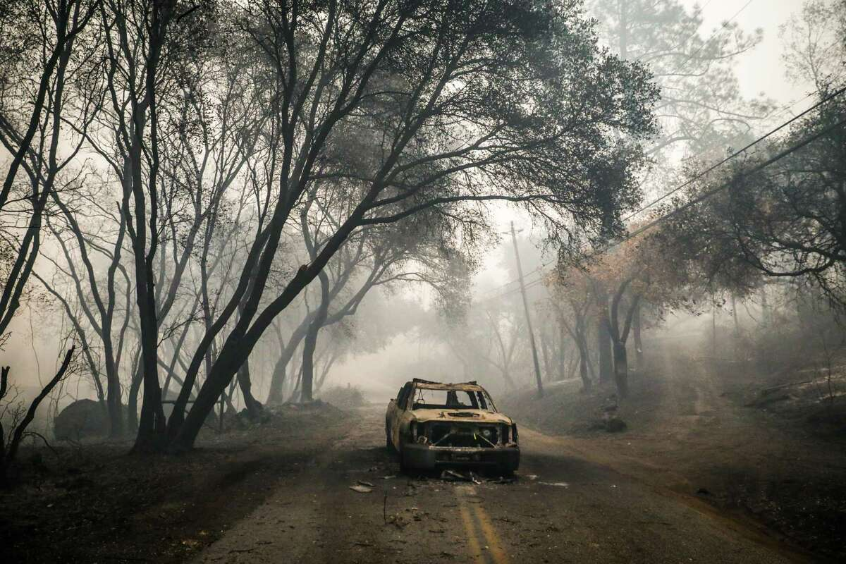 Camp Fire, 2018: 86 deaths Above: An incinerated car is seen abandoned a day after the Camp Fire tore through the area on Honey Run Road in Chico, California, on Friday, Nov. 9, 2018.