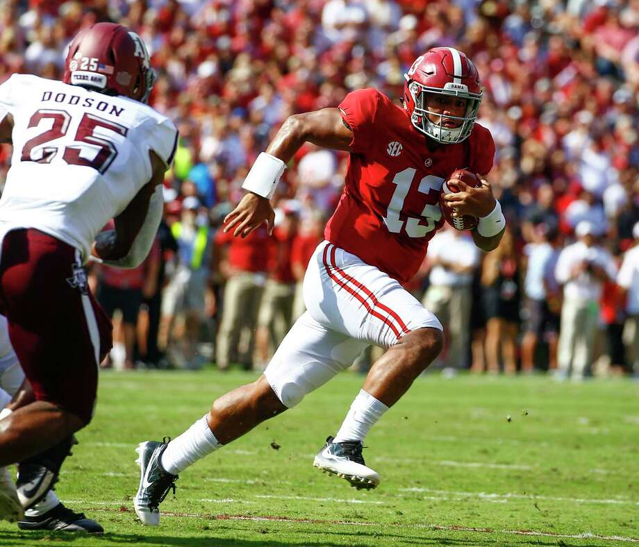 FILE - In this Sept. 22, 2018, file photo, Alabama quarterback Tua Tagovailoa (13) scrambles for a first down against Texas A&M during the first half of an NCAA college football game, in Tuscaloosa, Ala.  Tagovailoa is the offensive player of the year and one of five members of the top-ranked Crimson Tide to earn first-team honors on The Associated Press All-Southeastern Conference team, announced Monday, Dec. 3, 2018. (AP Photo/Butch Dill, File) Photo: Butch Dill / Copyright 2018 The Associated Press. All rights reserved.