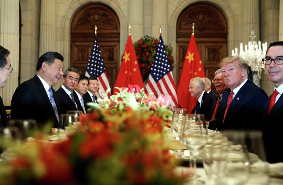 FILE - In this Dec. 1, 2018, file photo, U.S. President Donald Trump, second right, and China's President Xi Jinping, second left, attend their bilateral meeting at the G20 Summit in Buenos Aires, Argentina. A U.S.-Chinese cease fire on tariffs gives jittery companies a respite but does little to resolve a war over Beijing's technology ambitions that threatens to chill global economic growth. (AP Photo/Pablo Martinez Monsivais, File) Photo: Pablo Martinez Monsivais / Copyright 2018 The Associated Press. All rights reserved