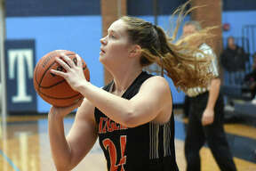 Edwardsville's Madelyn Stephen knocks down a baseline jumper in the first half for the Tigers.