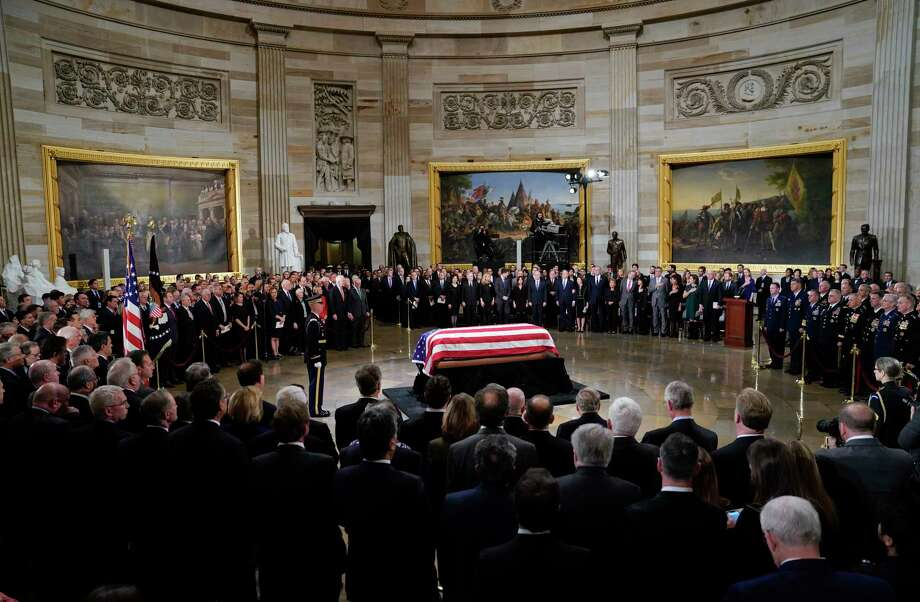 The flag-draped casket of former President George H.W. Bush lies in state in the Capitol Rotunda in Washington, Monday, Dec. 3, 2018. (AP Photo/Pablo Martinez Monsivais/Pool) Photo: Pool / Copyright 2018 The Associated Press. All rights reserved