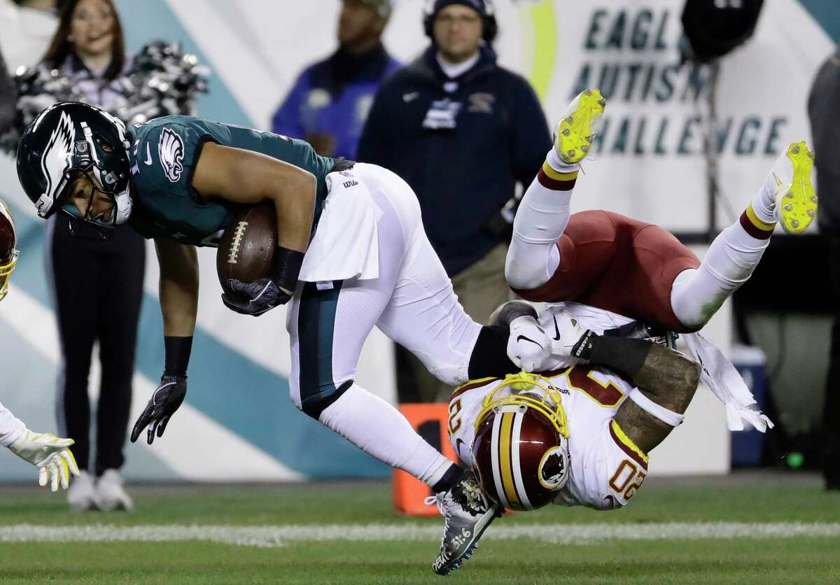 Philadelphia Eagles' Golden Tate (19) is tackled by Washington Redskins' Ha Ha Clinton-Dix (20) during the second half of an NFL football game, Monday, Dec. 3, 2018, in Philadelphia.