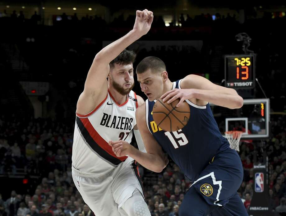 Denver Nuggets center Nikola Jokic, right, drives to the basket on Portland Trail Blazers center Jusuf Nurkic during the first half of an NBA basketball game in Portland, Ore., Friday, Nov. 30, 2018. (AP Photo/Steve Dykes) Photo: Steve Dykes / Associated Press