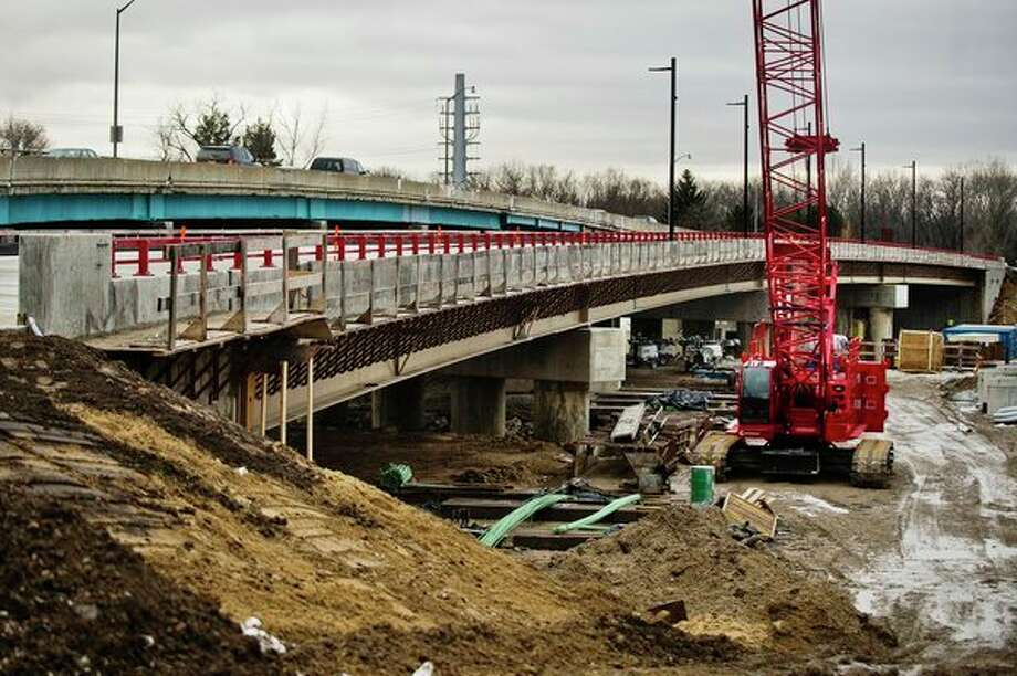 The newly constructed westbound lane of the M-20 bridge is estimated to be opened to traffic Thursday or Friday of this week, or early next week at the latest, depending on how quickly the concrete finishes curing, Michigan Department of Transportation officials told the Daily News on Monday. (Katy Kildee/kkildee@mdn.net)