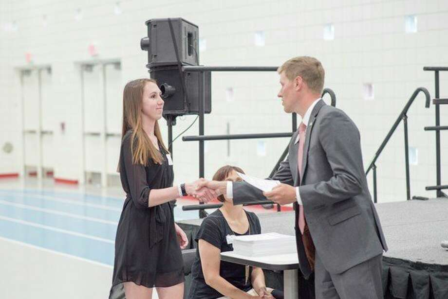 An award is given during the Midland Area Community Foundation spring scholarship reception. MACFwill accept scholarship applications online fromnow until March 1, 2019.(Photo provided)