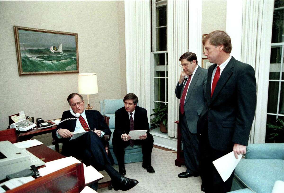 P08988-08A From the Oval Office Study, President Bush speaks on the phone to Sec. Cheney regarding the situation in Panama as Andy Card, John Sununu, and VP Quayle look on, 20 Dec 89. Photo Credit: George Bush Presidential Library and Museum