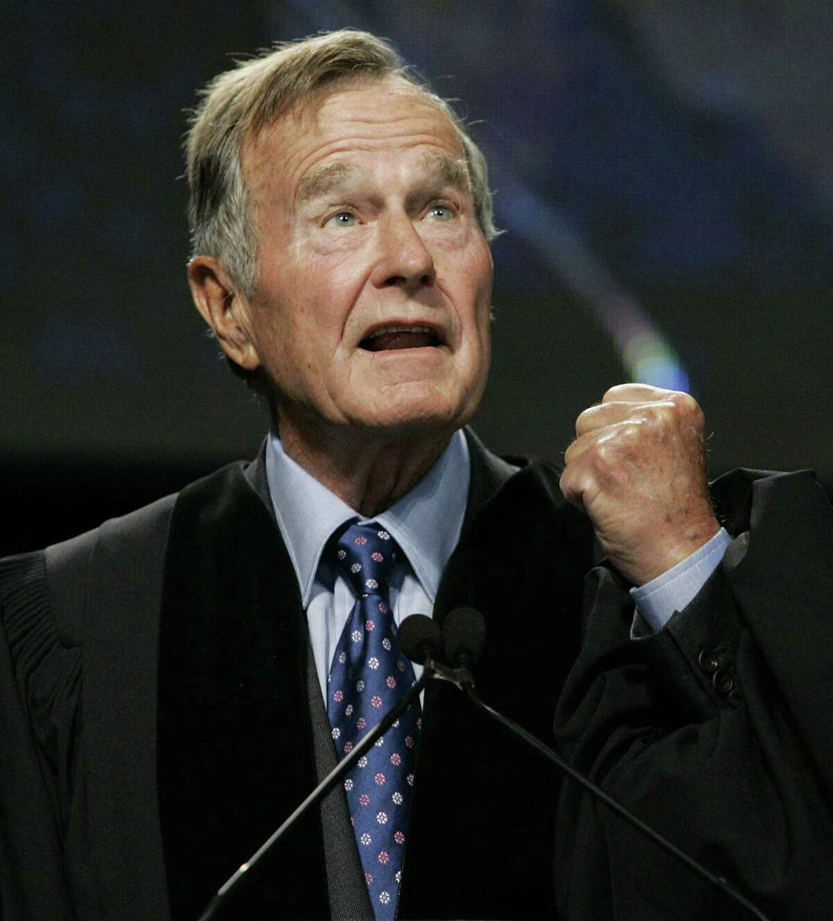In this Sept. 21, 2006 file photo, former President George H.W. Bush delivers the keynote speech before receiving an honorary Doctor of Public Administration degree at Suffolk University in Boston. (AP Photo/Elise Amendola, Pool, File)