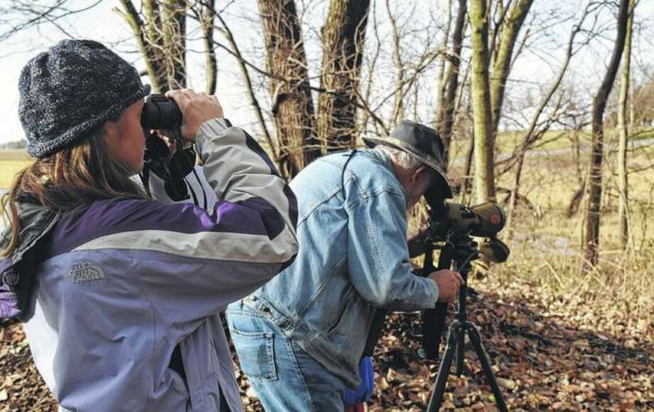 Samantha Boston (left) of Alexander and Pat Ward of Murrayville look at birds Saturday at the Emma Mae Leonhard Wildlife Sanctuary. Photo: Samantha McDaniel-Ogletree | Journal-Courier