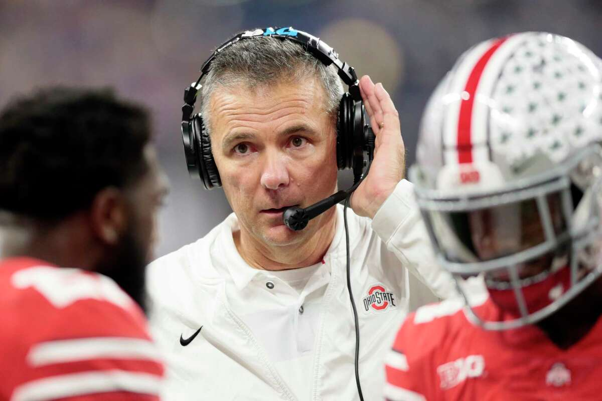 Ohio State head coach Urban Meyer listens on a head set on the sideline during the first half of the Big Ten championship NCAA college football game against Northwestern, Saturday, Dec. 1, 2018, in Indianapolis. (AP Photo/AJ Mast)