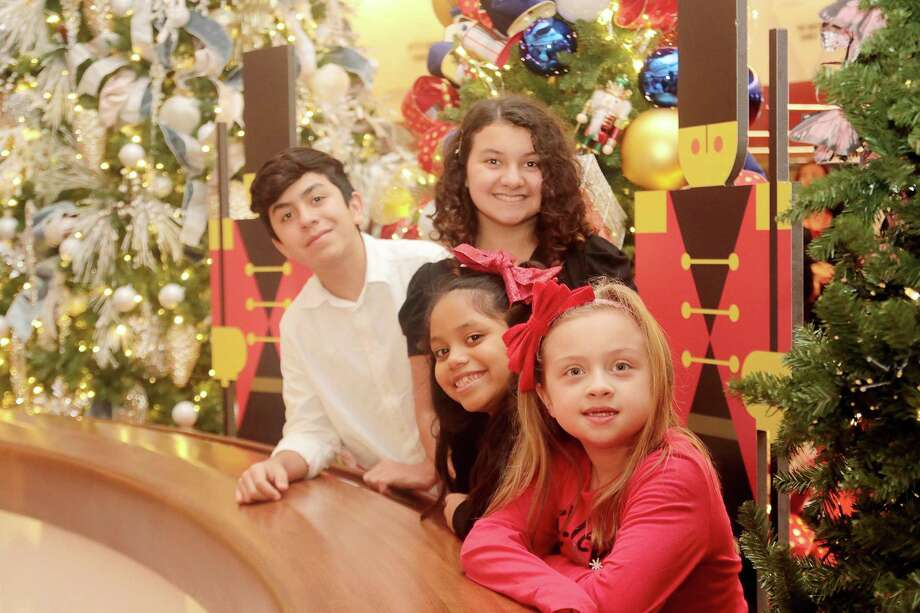 "Local youths Camille Hutchison, front, Ariel Molina, Ava Von Kanel and Ayden Molina perform in the Alley's production of ""A Christmas Carol."" Photo: Pin Lim, Freelance / For The Chronicle / Copyright Forest Photography, 2018."