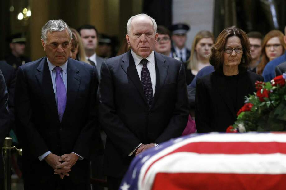 Former CIA directors George Tenet, left, and John Brennan pause alongside current director Gina Haspel in front of the flag-draped casket of former President George H.W. Bush as he lies in state in the Capitol Rotunda in Washington, Tuesday, Dec. 4, 2018. (AP Photo/Patrick Semansky) Photo: Patrick Semansky, STF / Associated Press / Copyright 2018 The Associated Press. All rights reserved.
