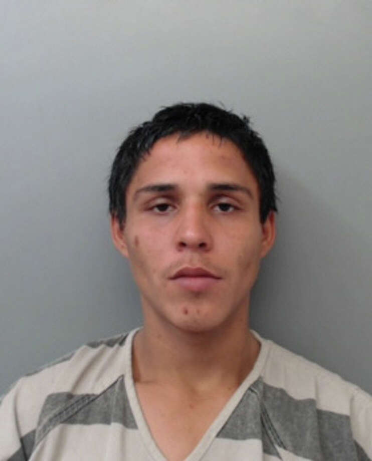 Jesus Ricardo Flores-Cadena, 22, was charged with burglary of a building and theft of property. Photo: Webb County Sheriff's Office