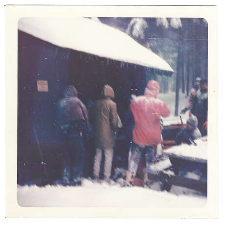 """Shenendehowa Hiking Club students stayed overnight in a lean-to after getting trapped in a snowstorm while hiking on the Long Trail in the Green Mountains of Vermont on Dec. 14 and 15, 1968. This photo was taken when rescuers arrived. (Photo by Keith Dayer) Photo: Eric """"Rick"""" Morgan, Provided"""