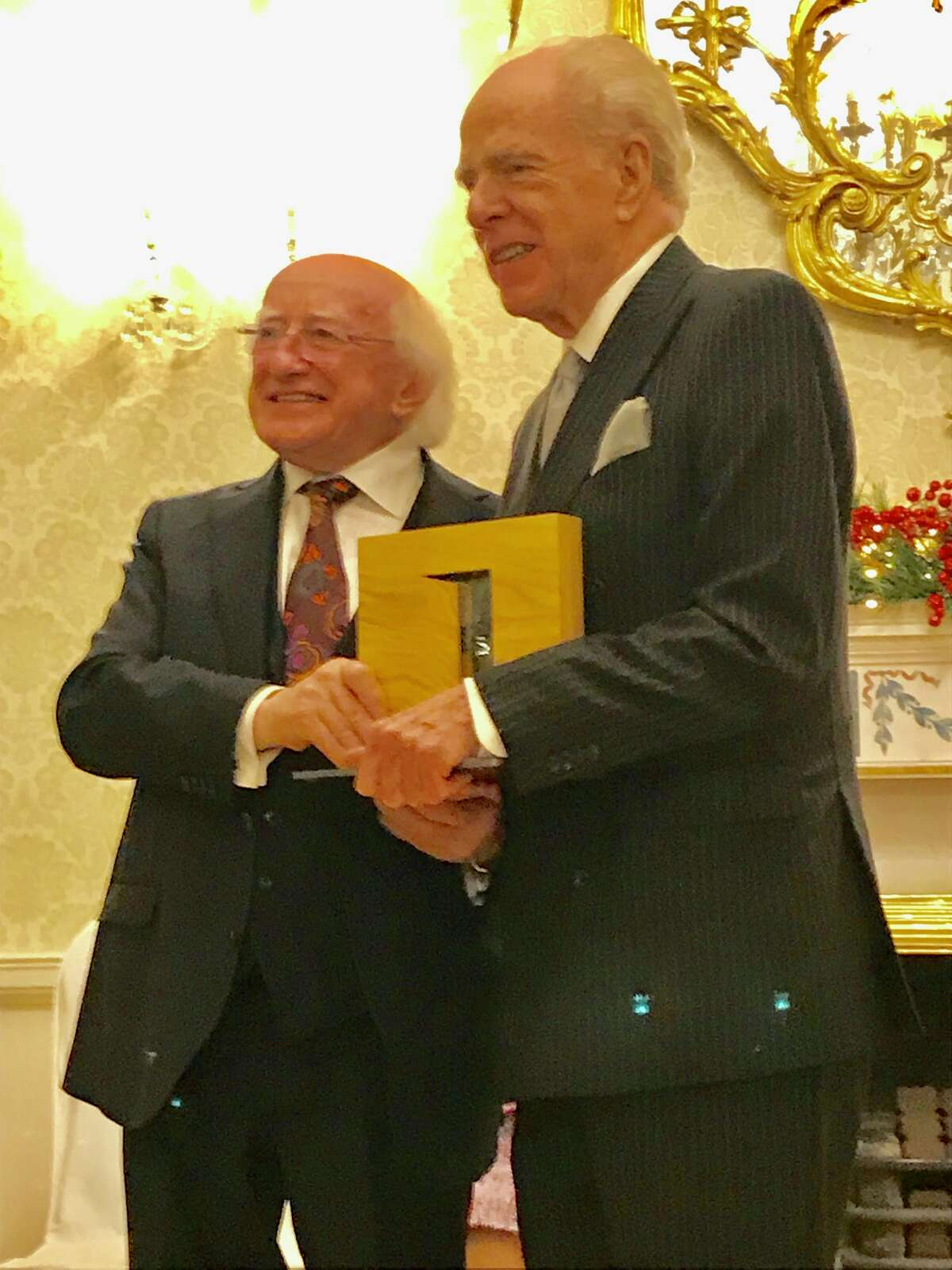 Ireland?'s President Michael D. Higgins presents William Kennedy with the Presidential Distinguished Service Award for the Irish Abroad in Dublin on Thursday, Nov. 29, 2018.