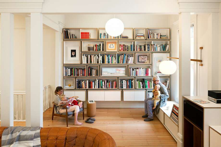 Caitlin Williams Freeman and husband James Freeman relaxwith their children in the library of their S.F. home. Photo: Adam Rouse