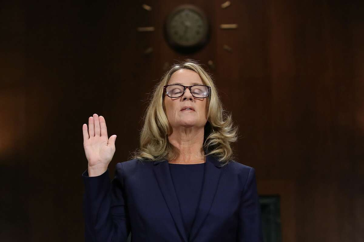 Christine Blasey Ford is sworn in before testifying the Senate Judiciary Committee in the Dirksen Senate Office Building on Capitol Hill September 27, 2018 in Washington, DC.