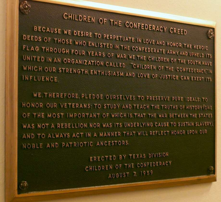 SPECIAL TO THE HOUSTON CHRONICLE...TXHOU..This is a view of the plaque bearing the Children of the Confederacy Creed mounted in a hallway inside the Texas Capitol on Friday, July 7, 2000, in Austin, Texas. (AP Photo) Photo: HARRY CABLUCK, STF / AP / AP