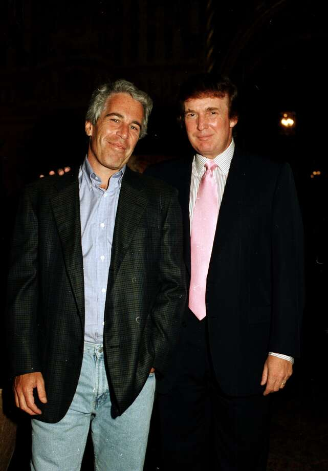 Portrait of American financier Jeffrey Epstein (left) and real estate developer Donald Trump as they pose together at the Mar-a-Lago estate, Palm Beach, Florida, 1997. Photo: Davidoff Studios Photography/Getty Images