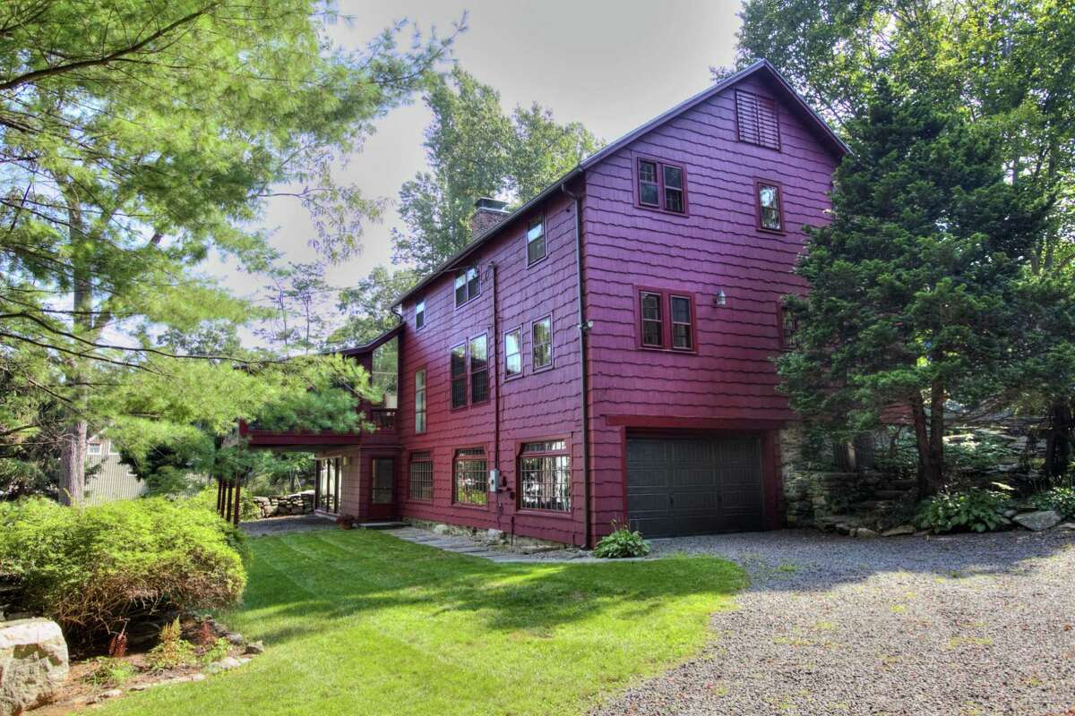This updated antique converted barn has an attached, under house two-car heated garage that can fit a third car in a tandem space.