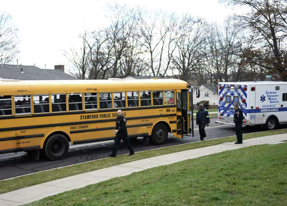 Police and EMTs assist following a minor accident between a school bus and an ambulance on Myano Lane in Stamford, Conn. Monday, Dec. 3, 2018. Photo: Tyler Sizemore / Hearst Connecticut Media / Greenwich Time