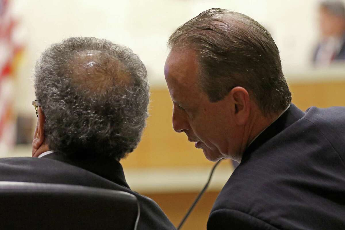 Special prosecutors Brian Wice, right, talks with Kent Schaffer during a pre-trial motion hearing in the Texas Attorney General Ken Paxton case at the Collin County courthouse on Tuesday, Dec. 1, 2015, in McKinney, Texas. Both are special prosecutors tapped to build a case against Paxton but have not been paid by the county since 2016. (Jae S. Lee/The Dallas Morning News)