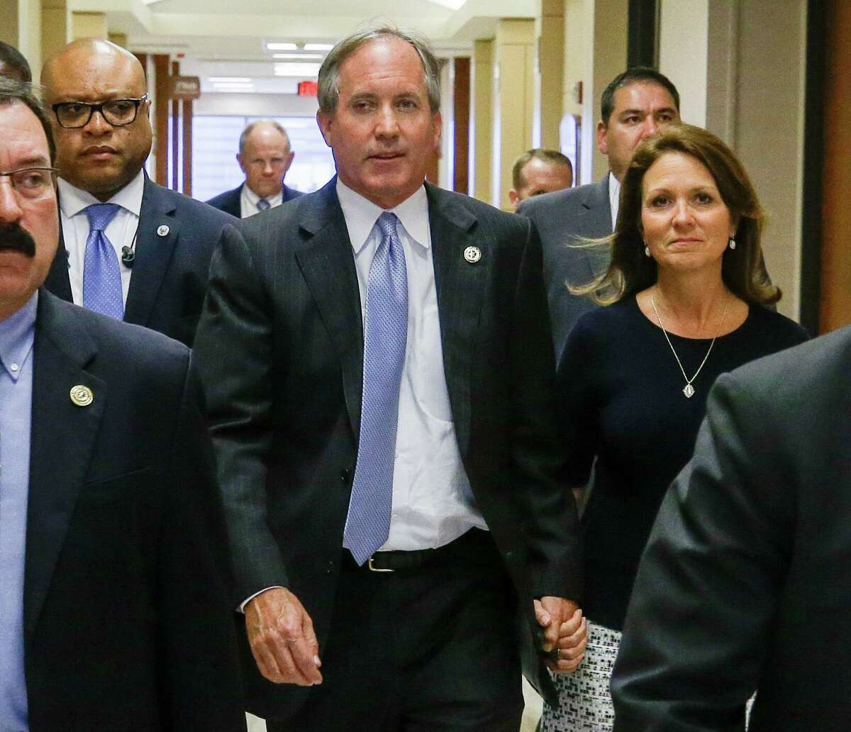 Republican Texas Attorney General Ken Paxton and his wife Angela Paxton, arrive for a hearing in the Harris County Criminal District Court in Houston, Thursday, July 27, 2017. A new trial date of Dec. 11 is set for Ken Paxton to face felony securities fraud charges. It's the third time a trial date has been set. (Melissa Phillip/Houston Chronicle via AP