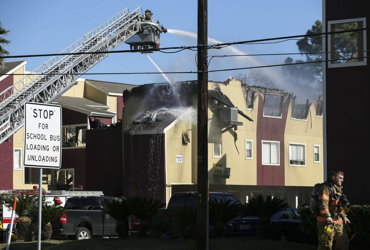 Firefighters from Seabrook and La Porte work to contain a fire that damaged two La Porte apartment buildings on Monday, Dec. 4, 2018. The fire started about 9 a.m. in one building and the strong wind spread the fire to another building.