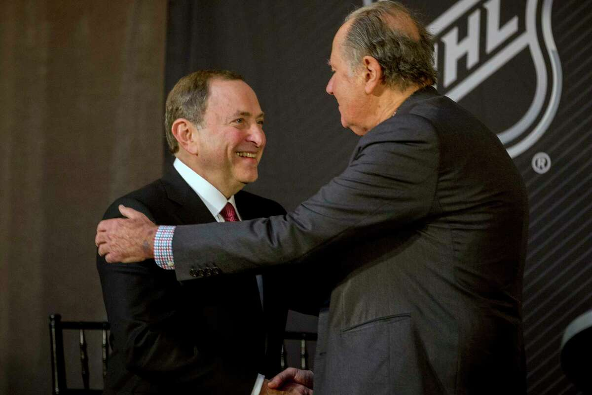 NHL commissioner Gary Bettman, left, shakes hands with Seattle Hockey Partners majority owner David Bonderman after the announcement by the National Hockey League Board of Governors to name Seattle as the home of the league's 32nd franchise, Tuesday, Dec. 4, 2018, in Sea Island, Ga.