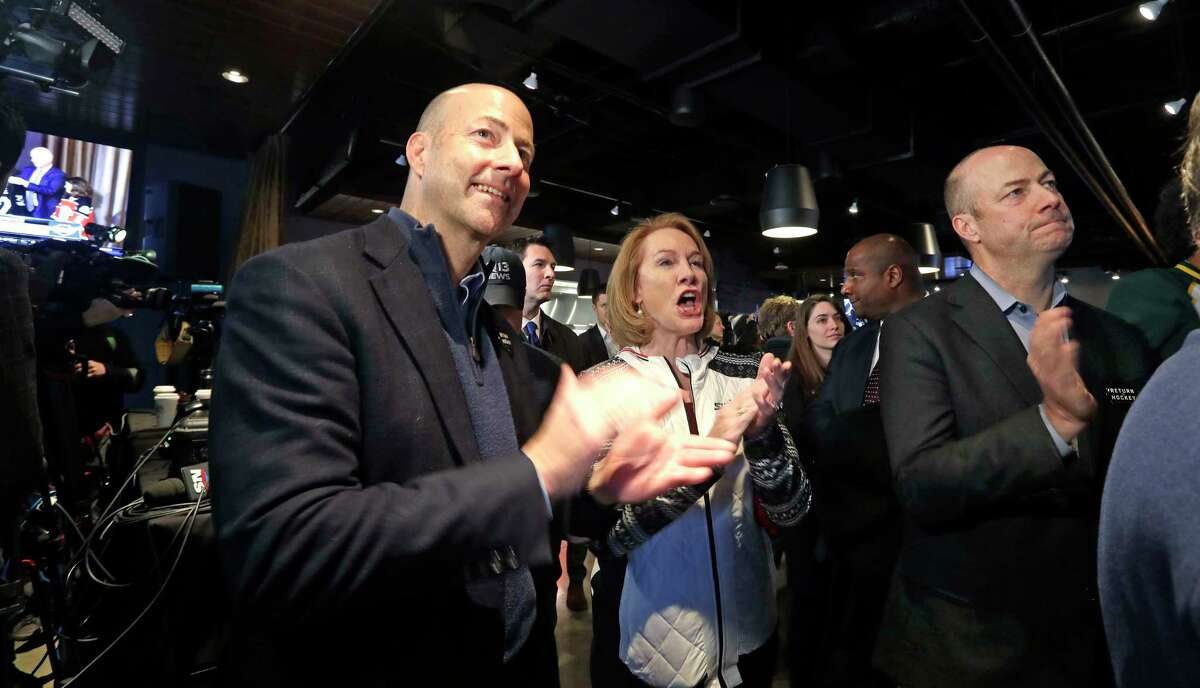Seattle Mayor Jenny Durkan, center, cheers the announcement of a new NHL hockey team in Seattle with brothers Ted Ackerley, left, and Chris Ackerley at a celebratory party Tuesday, Dec. 4, 2018, in Seattle. The NHL Board of Governors unanimously approved adding Seattle as the league's 32nd franchise on Tuesday, with play set to begin in 2021 to allow enough time for arena renovations.