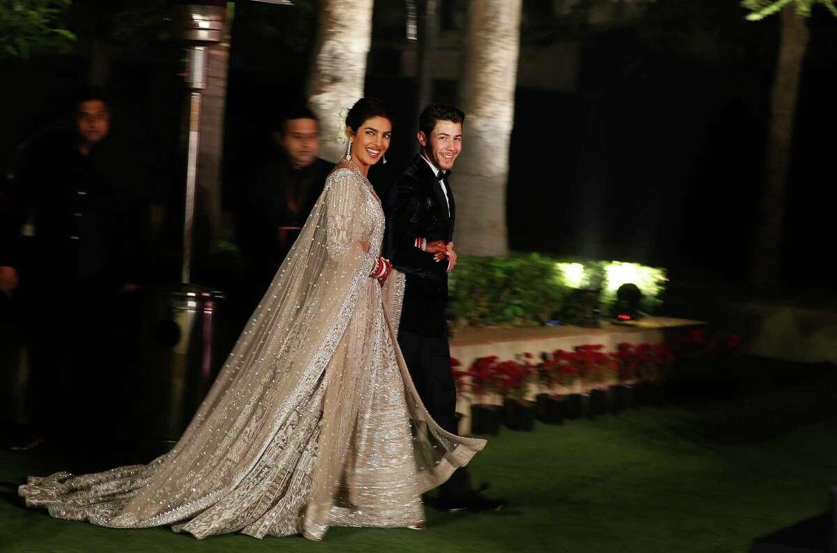 Bollywood actress Priyanka Chopra and musician Nick Jonas arrive for their wedding reception in New Delhi, India, Tuesday, Dec. 4, 2018. (AP Photo/Altaf Qadri)