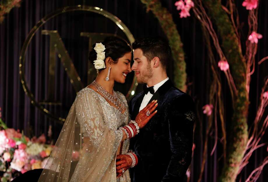 Bollywood actress Priyanka Chopra and musician Nick Jonas stand for photographs at their wedding reception in New Delhi, India, Tuesday, Dec. 4, 2018. (AP Photo/Altaf Qadri) Photo: Associated Press / Copyright 2018 The Associated Press. All rights reserved.