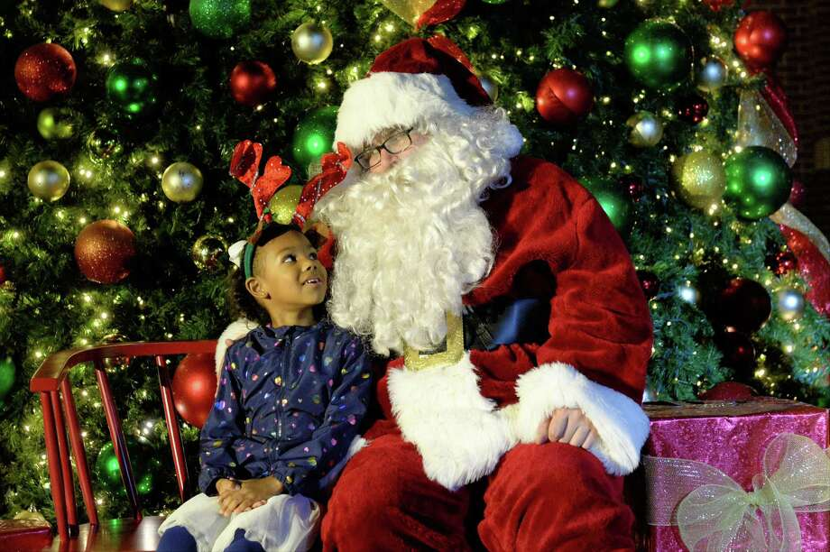 Madison Maynz of Katy visits with Santa Claus during the Holiday Tree Lighting Ceremony at Katy City Hall, Thursday, November 29, 2018. Photo: Craig Moseley, Houston Chronicle / Staff Photographer / ©2018 Houston Chronicle