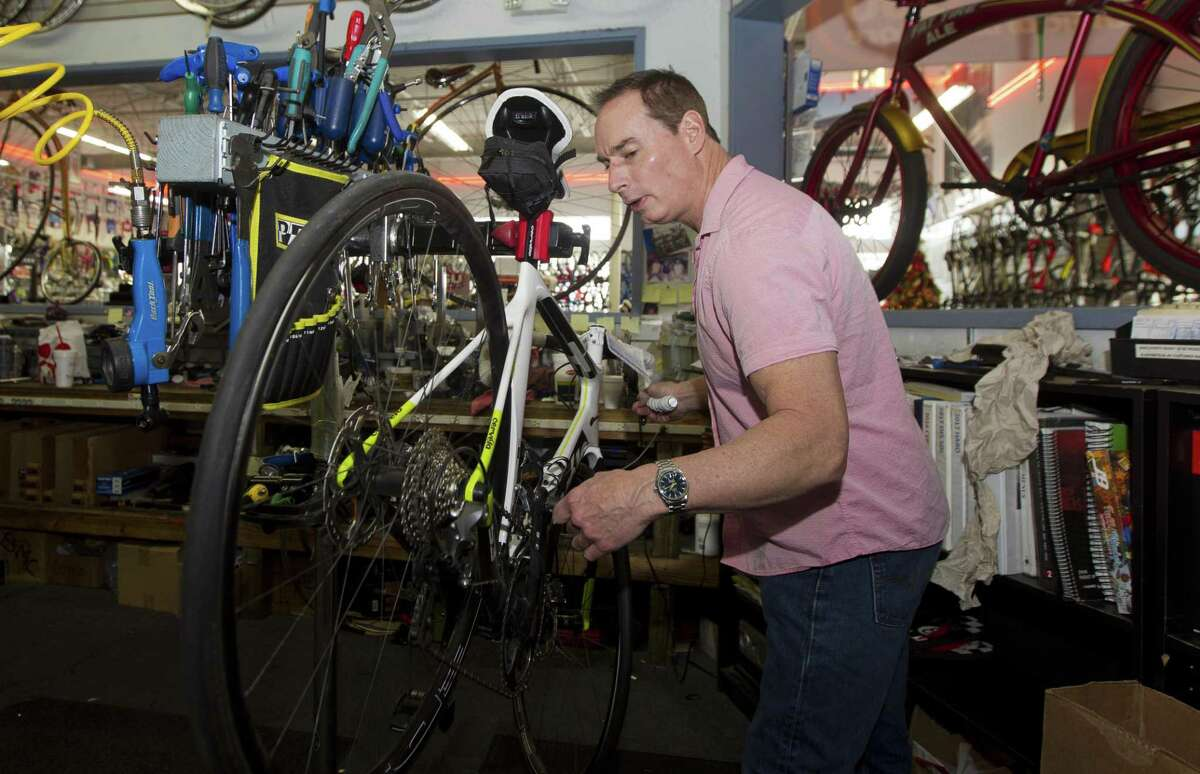 Ken Thurlow, manager of Bike Lane, works on a bicycle, Tuesday, Nov. 27, 2018, in Shenandoah. Thurlow is the man behind the