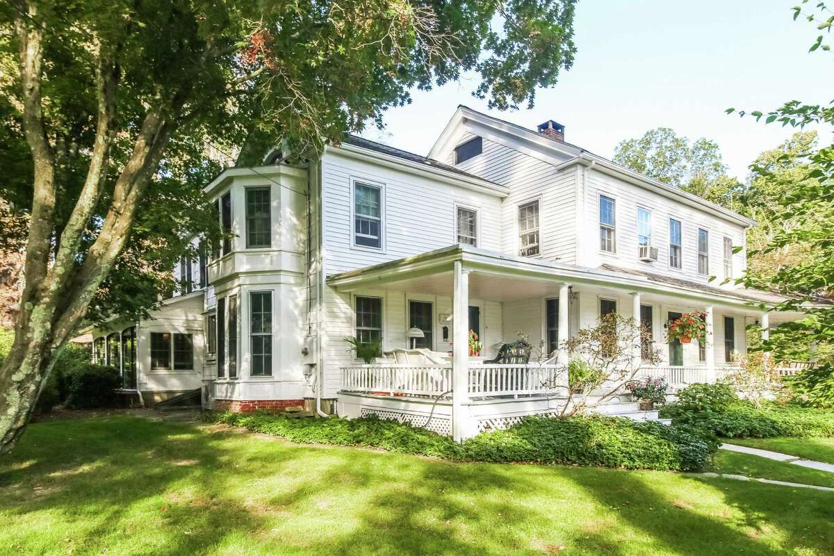 The antique farmhouse at 82 Obtuse Road South is on almost 4 acres with a pool.