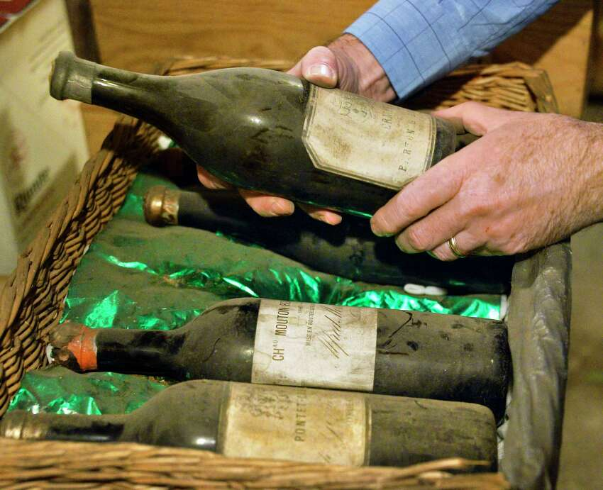 New owner Joe Maloney examines old wine bottles in the cellar of The Wine Shop Tuesday Dec. 4, 2018 in Albany, NY. The Wine Shop is celebrating its 85th anniversary, opening the day Prohibition ended on Dec. 5, 1933. (John Carl D'Annibale/Times Union)