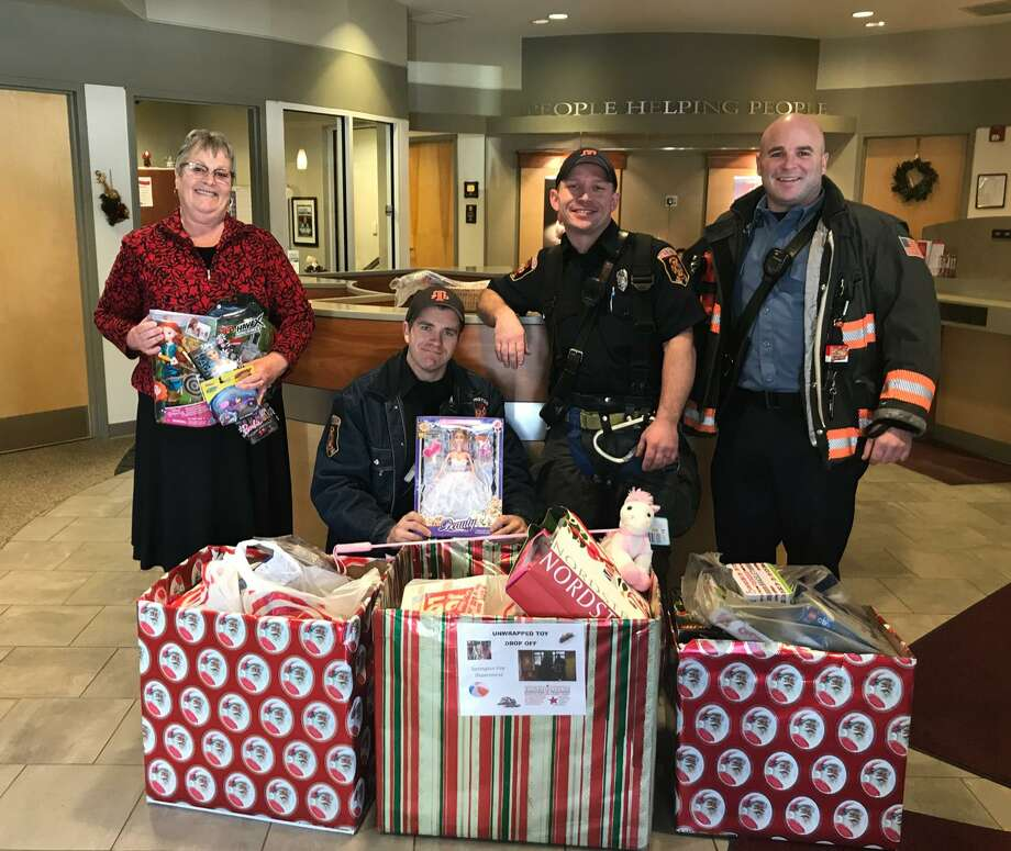 Torrington firefighters picked up a delivery of toys for its Christmas for Children drive from the Torrington Municipal Teachers Federal Credit Union in 2017. The credit union is collecting toys and donations again this year, along with other organizations in town, to support the drive. Photo: /