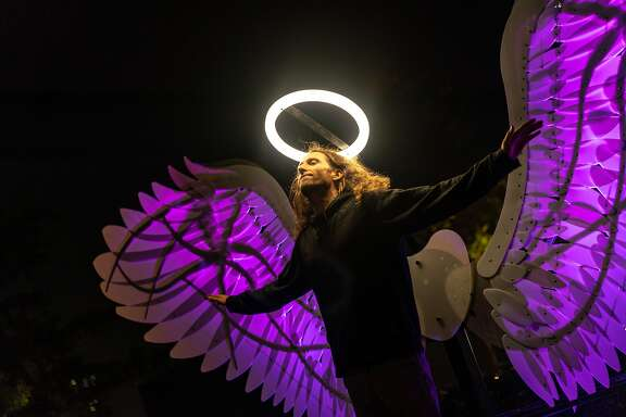 HONG KONG, HONG KONG - NOVEMBER 29: Attendee poses for a photograph at the Angels of Freedom by OGE Creative Group of Israel during the 2018 Hong Kong Pulse Light Festival on November 29, 2018 in Hong Kong, Hong Kong. (Photo by Anthony Kwan/Getty Images for Hong Kong Tourism Board)
