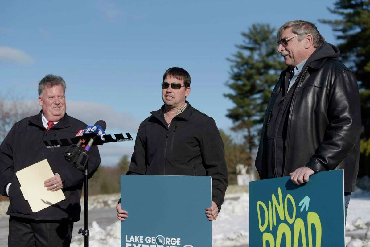 John Collins, left, the new COO and GM of Dino Roar Valley at Lake George Expedition Park, Ruben Ellsworth, center, who will be the new owner of the park, and Jack Gillete, the current owner of Magic Forest amusement park, take part in a press conference to announce the sale of the park and the plans for a new Dino Roar attraction on Tuesday, Dec. 4, 2018, in Lake George, N.Y. (Paul Buckowski/Times Union)