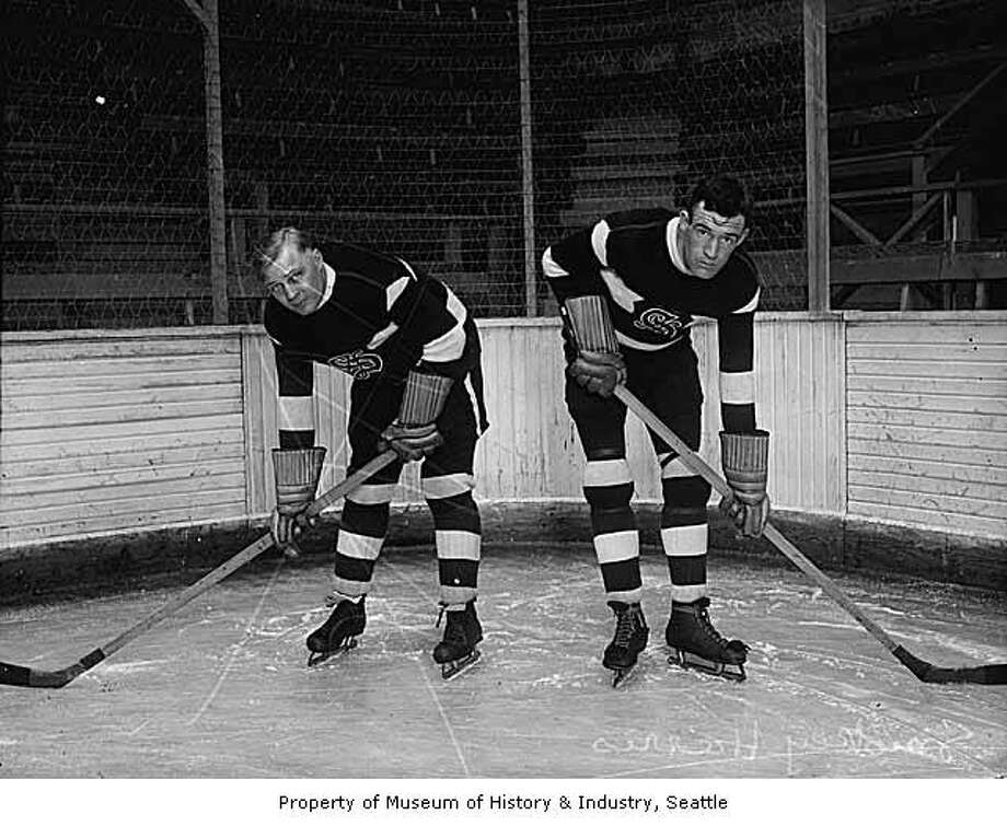 """Henry Harris, brother to the Seattle Metropolitans player Wilfred 'Smokey' Harris, played forward for the Seattle Eskimos from 1928-1930.  Known for his aggressive and rough play, he held the Pacific Coast Hockey League record for penalty minutes during the 1928-29 season.  Robert John 'Bobby' Benson played defense for the Seattle Eskimos late in his long hockey career from 1929-1931."" -MOHAI. Photo, dated 1929 courtesy MOHAI, Seattle P-I Collection, image number 1986.5G.985.1. Photo: Courtesy MOHAI"