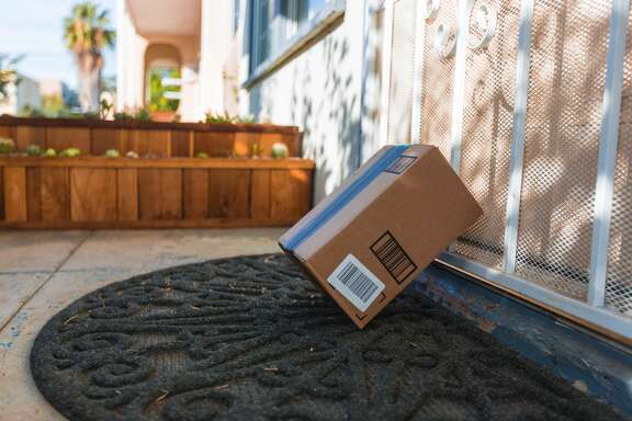 Cardboard package delivery at front door during the holiday season