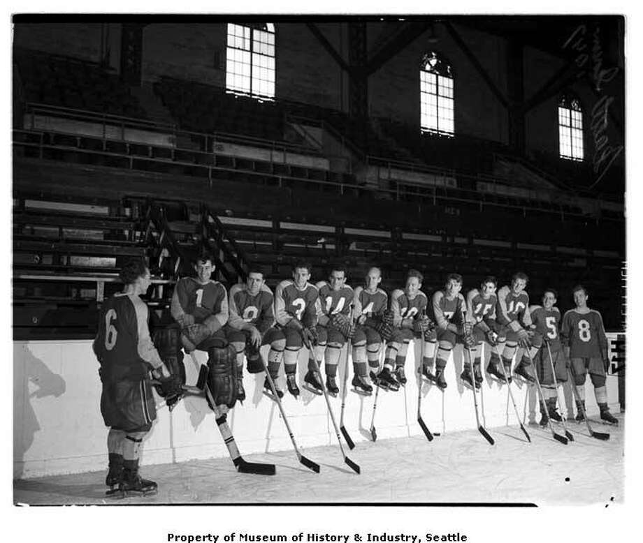"""""""In October 1947, the Seattle Ironmen opened at the Civic Arena against the Vancouver Canucks. The team played in the northern division of the Pacific Coast Ice Hockey League through the 1951 season. This October 1947 photo shows the Seattle Ironmen sitting at the edge of the ice rink at the Civic Arena, now Mercer Arena at Seattle Center."""" -MOHAI. Photo, dated 1947, courtesy MOHAI, Seattle P-I Collection, image numberPI26812. Photo: Courtesy MOHAI"""