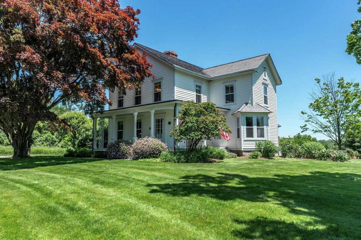 The 1870 antique colonial on Oenoke Ridge is in the heart of New Canaan and the 2.93-acre property is listed for $3.395 million.